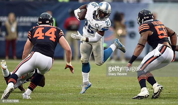 Theo Riddick of the Detroit Lions is pursued by Nick Kwiatkoski and Jerrell Freeman of the Chicago Bears during the second half of a game at Soldier...