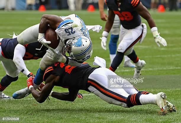 Theo Riddick of the Detroit Lions is stopped short of the goal by Harold JonesQuartey of the Chicago Bears at Soldier Field on October 2 2016 in...