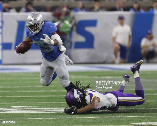 Theo Riddick of the Detroit Lions is tackled by Trae Waynes of the Minnesota Vikings during an NFL game at Ford Field on November 23 2016 in Detroit...