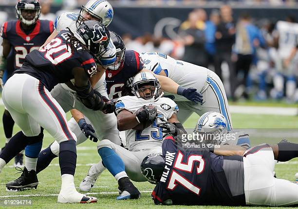 Theo Riddick of the Detroit Lions is tackled by Vince Wilfork of the Houston Texans in the third quarter at NRG Stadium on October 30 2016 in Houston...