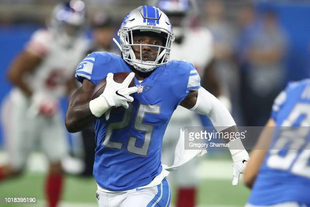 Theo Riddick of the Detroit Lions looks for yards after a first half catch while playing the New York Giants during a pre season game at Ford Field...