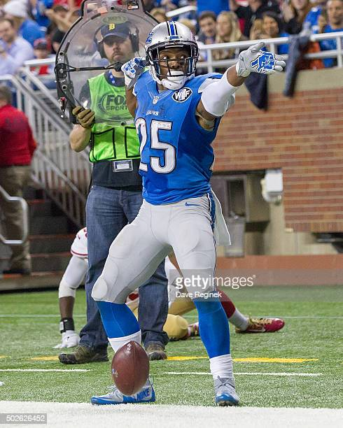 Theo Riddick of the Detroit Lions points down field after getting a first down during an NFL game against the San Francisco 49ers at Ford Field on...
