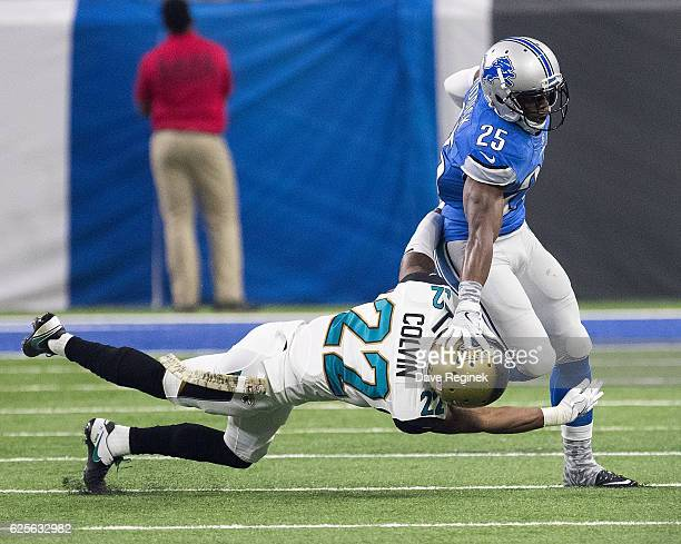 Theo Riddick of the Detroit Lions pushes off a tackle from Aaron Colvin of the Jacksonville Jaguars during an NFL game at Ford Field on November 20...