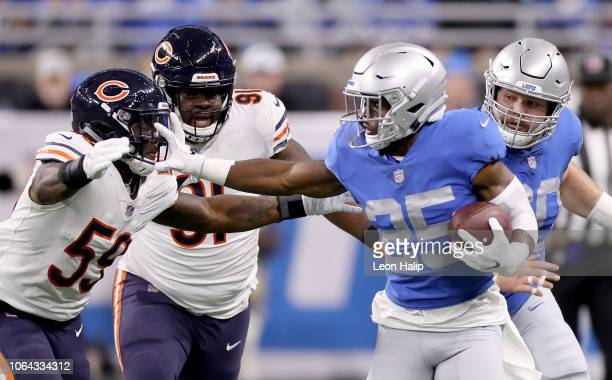 Theo Riddick of the Detroit Lions pushes off on the face mask of Danny Trevathan of the Chicago Bears during the first quarter at Ford Field on...