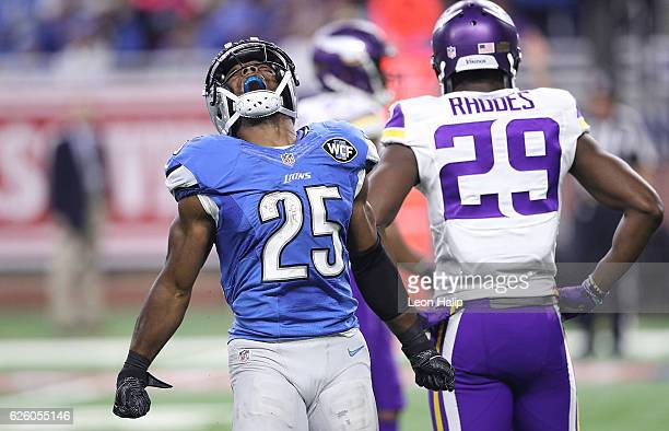 Theo Riddick of the Detroit Lions reacts after running for a first down during the third quarter of the annual Thanksgiving game against the...