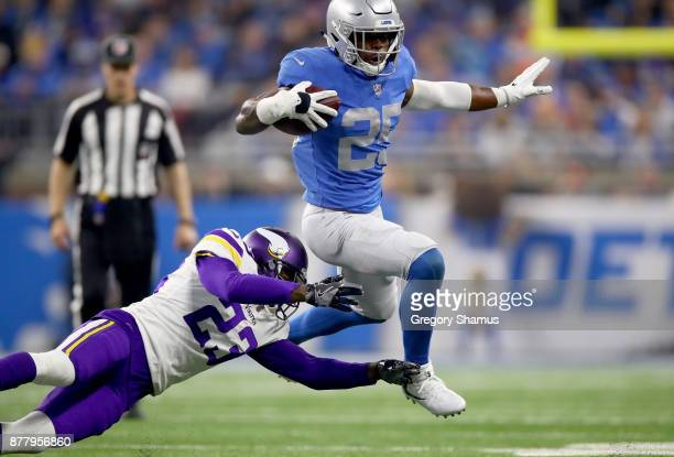 Theo Riddick of the Detroit Lions runs against Terence Newman of the Minnesota Vikings during the third quarter at Ford Field on November 23 2017 in...