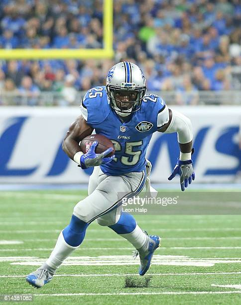 Theo Riddick of the Detroit Lions runs for a first down as Rodney McLeod of the Philadelphia Eagles looks to make the stop during the second quarter...