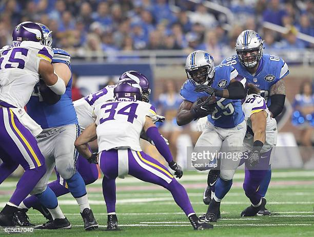 Theo Riddick of the Detroit Lions runs for a first down during the fourth quarter of the annual Thanksgiving day game against the Minnesota Vikings...