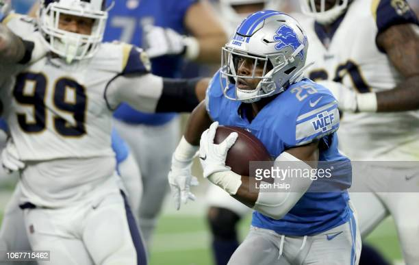 Theo Riddick of the Detroit Lions runs for yardage against the Los Angeles Rams during the first half at Ford Field on December 2 2018 in Detroit...
