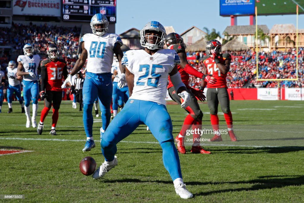 Theo Riddick #25 of the Detroit Lions runs into the end zone for an 18-yard touchdown in the third quarter of a game against the Tampa Bay Buccaneers at Raymond James Stadium on December 10, 2017 in Tampa, Florida. The Lions won 24-21.