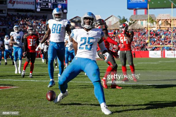 Theo Riddick of the Detroit Lions runs into the end zone for an 18yard touchdown in the third quarter of a game against the Tampa Bay Buccaneers at...