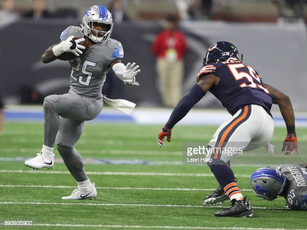 Theo Riddick of the Detroit Lions runs the ball against Danny Trevathan of the Chicago Bears during the first half at Ford Field on December 16 2017...