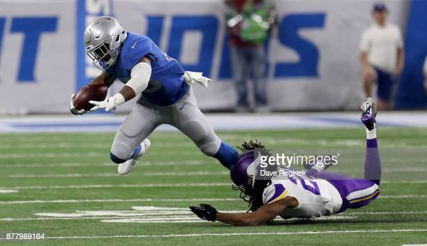 Theo Riddick of the Detroit Lions runs the ball against Trae Waynes of the Minnesota Vikings during the second half at Ford Field on November 23 2016...