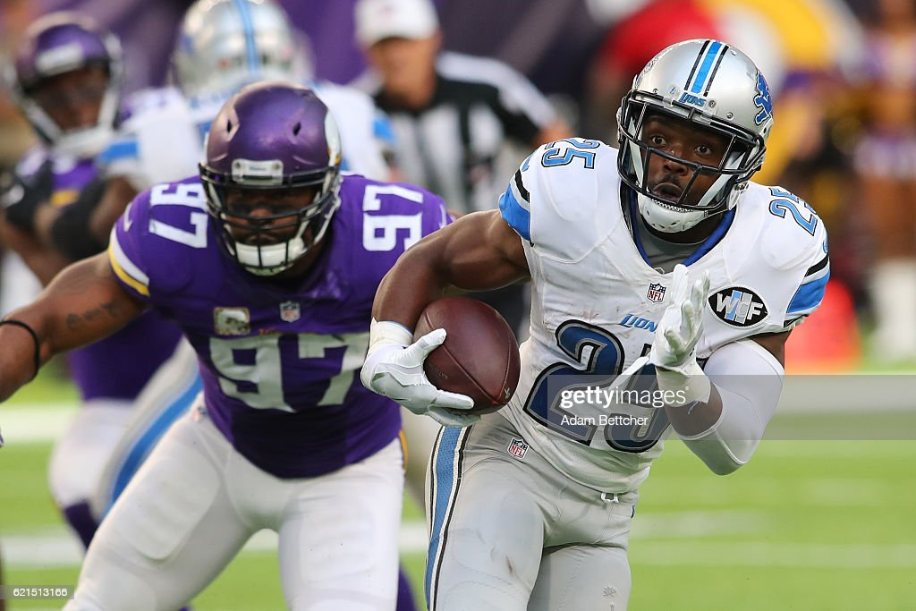 Theo Riddick #25 of the Detroit Lions runs the ball during the second half of the game on November 6, 2016 at US Bank Stadium in Minneapolis, Minnesota.