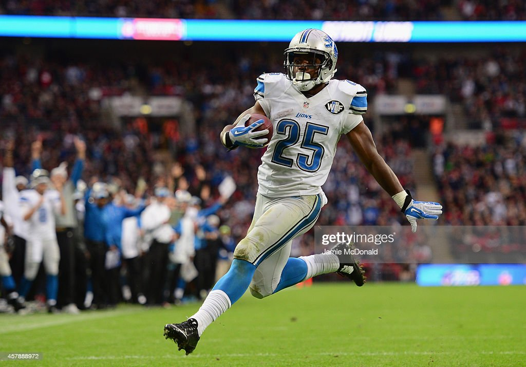 Theo Riddick #25 of the Detroit Lions runs through to score a touchdown in the fourth quarter during the NFL match between Detroit Lions and Atlanta Falcons at Wembley Stadium on October 26, 2014 in London, England.