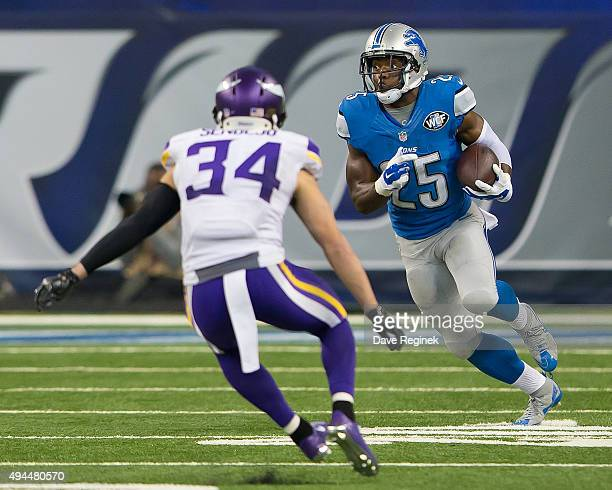 Theo Riddick of the Detroit Lions runs with the ball during an NFL game against the Minnesota Vikings at Ford Field on October 25 2015 in Detroit...