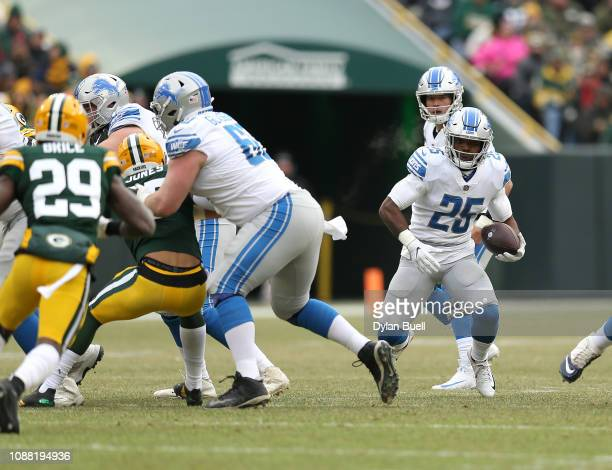 Theo Riddick of the Detroit Lions runs with the ball during the first half of a game against the Green Bay Packers at Lambeau Field on December 30...