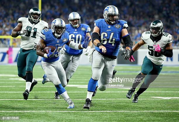 Theo Riddick of the Detroit Lions runs with the ball for his second touchdown of the first quarter against the Philadelphia Eagles at Ford Field on...