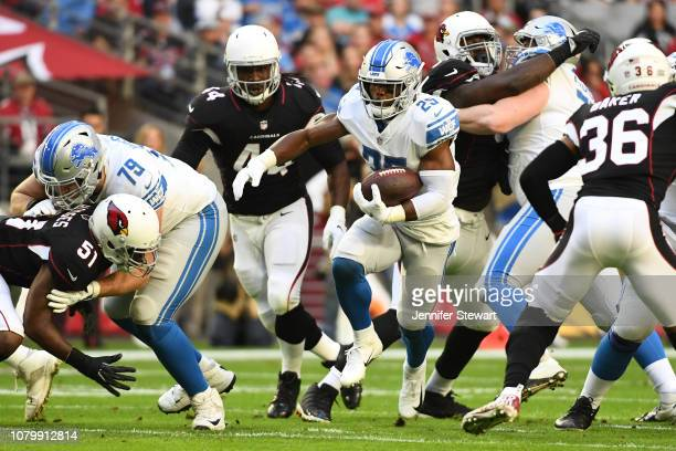 Theo Riddick of the Detroit Lions runs with the ball in the first half of the NFL game against the Arizona Cardinals at State Farm Stadium on...