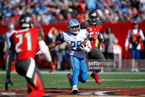 Theo Riddick of the Detroit Lions runs with the ball in the first quarter of a game against the Tampa Bay Buccaneers at Raymond James Stadium on...