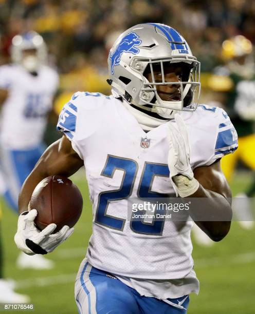 Theo Riddick of the Detroit Lions runs with the ball in the fourth quarter against the Green Bay Packers at Lambeau Field on November 6 2017 in Green...