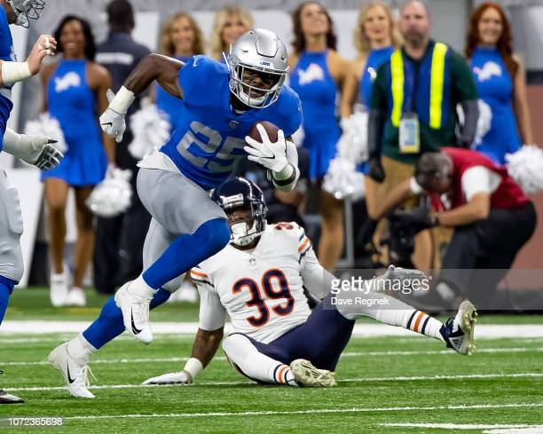 Theo Riddick of the Detroit Lions runs with the football past Eddie Jackson of the Chicago Bears during an NFL Thanksgiving Day game at Ford Field on...