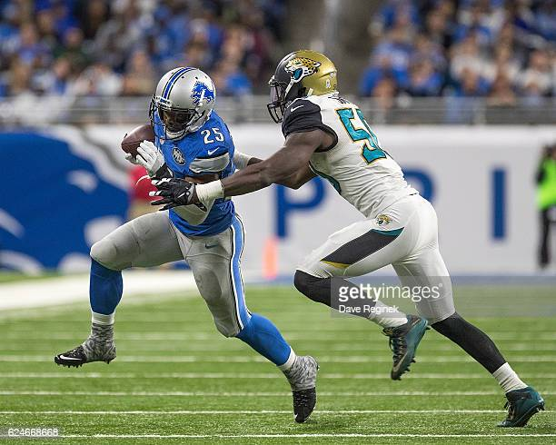 Theo Riddick of the Detroit Lions tries to avoid the tackle from Telvin Smith of the Jacksonville Jaguars during an NFL game at Ford Field on...
