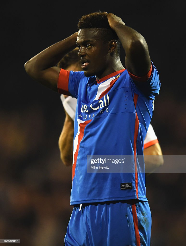 Theo Robinson of Doncaster reacts after seeing his penalty saved by Marcus Bettinelli of Fulham during the Capital One Cup Third Round match between Fulham and Doncaster Rovers at Craven Cottage on September 23, 2014 in London, England.