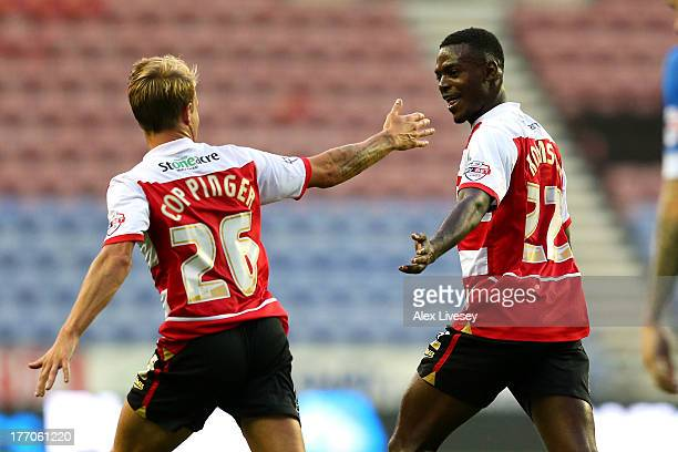 Theo Robinson of Doncaster Rovers celebrates with James Coppinger after scoring the opening goal during the Sky Bet Championship match between Wigan...