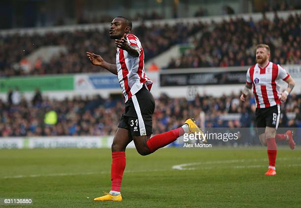 Theo Robinson of Lincoln City celebrates after scoring his sides first goal during the Emirates FA Cup third round match between Ipswich Town and...