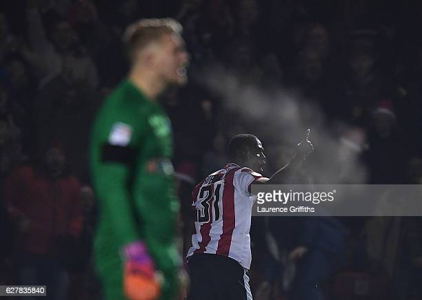Theo Robinson of Lincoln City celebrates scoring the opening goal in front of Connor Ripley of Lincoln City during the Emirates FA Cup Second Round...