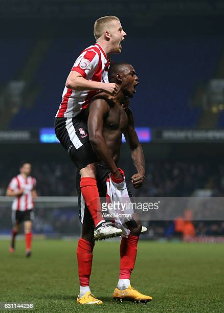 Theo Robinson of Lincoln City celebrates with Bradley Wood of Lincoln City after scoring his sides second goal during the Emirates FA Cup third round...