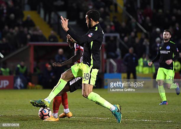 Theo Robinson of Lincoln City scores his side's third goal during the Emirates FA Cup Fourth Round match between Lincoln City and Brighton and Hove...