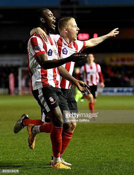 Theo Robinson of Lincoln Citycelebrates scoring his side's third goal during the Emirates FA Cup Fourth Round match between Lincoln City and Brighton...