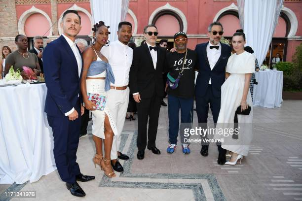 Theo Rossi Milauna Jemai Jackson Nate Parker Joaquin Phoenix Spike Lee Todd Phillips and Rooney Mara attend the HFPA cocktail reception during the...