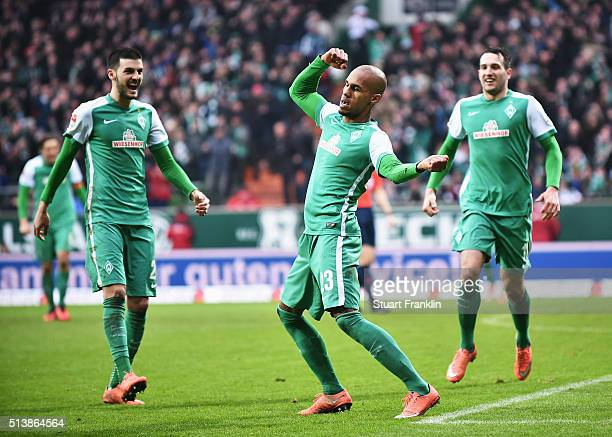 Theo Selassie of Bremen celebrates scoring the third goal during the Bundesliga match between Werder Bremen and Hannover 96 at Weserstadion on March...