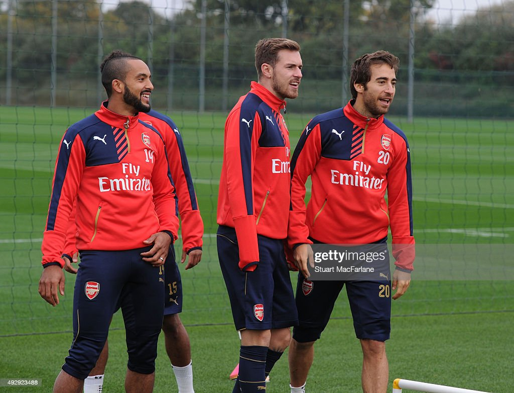 Theo Walcott, Aaron Ramsey and Mathieu Flamini of Arsenal during a training session at London Colney on October 16, 2015 in St Albans, England.
