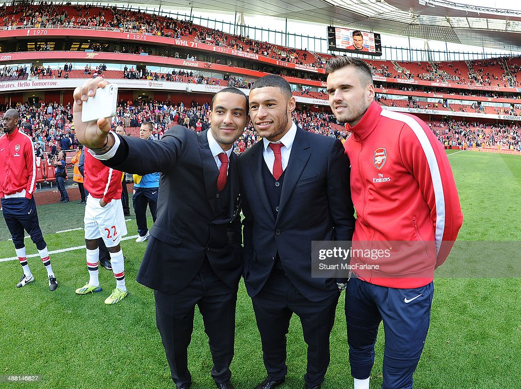 Theo Walcott, Alex Oxlade-Chamberain and Carl Jenkinson of Arsenal after the Barclays Premier League match between Arsenal and West Bromwich Albion at Emirates Stadium on May 4, 2014 in London, England.