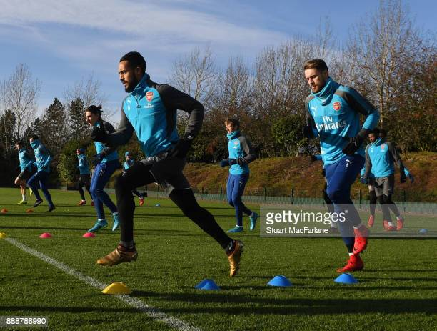 Theo Walcott and Aaron Ramsey of Arsenal during a training session at London Colney on December 9 2017 in St Albans England