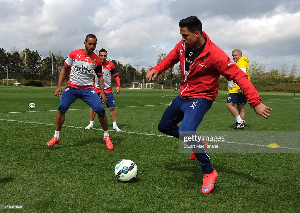 Theo Walcott and Alexis Sanchez of Arsenal during a training session at London Colney on April 25, 2015 in St Albans, England.