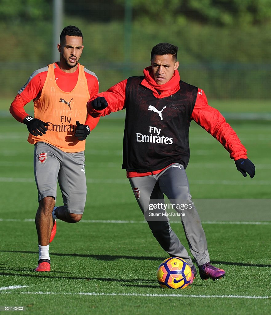 Theo Walcott and Alexis Sanchez of Arsenal during a training session at London Colney on November 18, 2016 in St Albans, England.