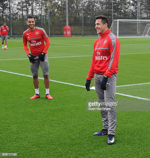 Theo Walcott and Alexis Sanchez of Arsenal during a training session at London Colney on December 9 2016 in St Albans England