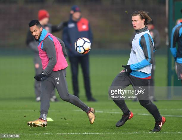 Theo Walcott and Ben Sheaf of Arsenal during a training session at London Colney on January 6 2018 in St Albans England