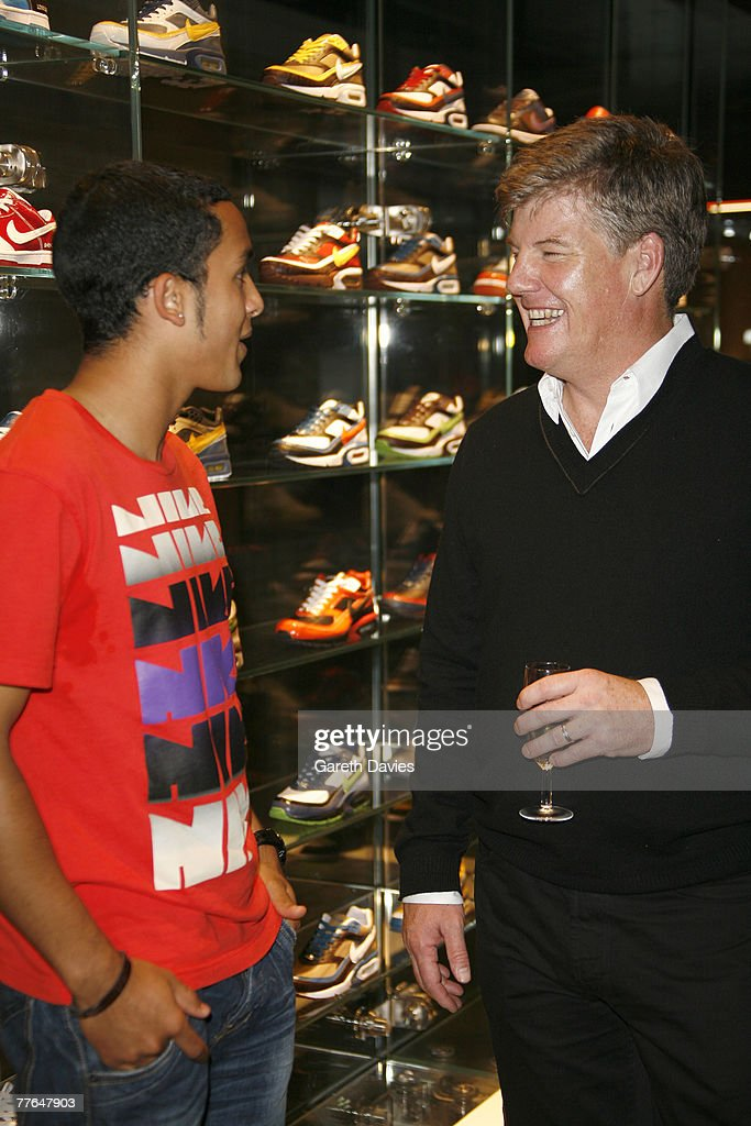 Theo Walcott and CEO of Nike Charlie Denson at the launch of Nike ID Studio  at