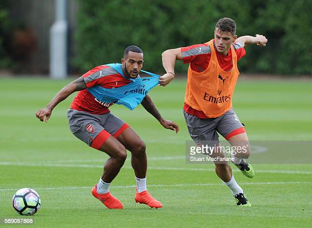 Theo Walcott and Granit Xhaka of Arsenal during a training session on August 13 2016 in St Albans England