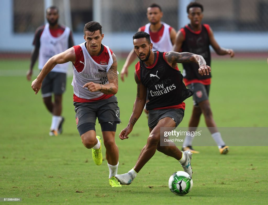 Theo Walcott and Granit Xhaka of Arsenal during an Arsenal Training Session at Yuanshen Sports Centre Stadium on July 17, 2017 in Shanghai, China.