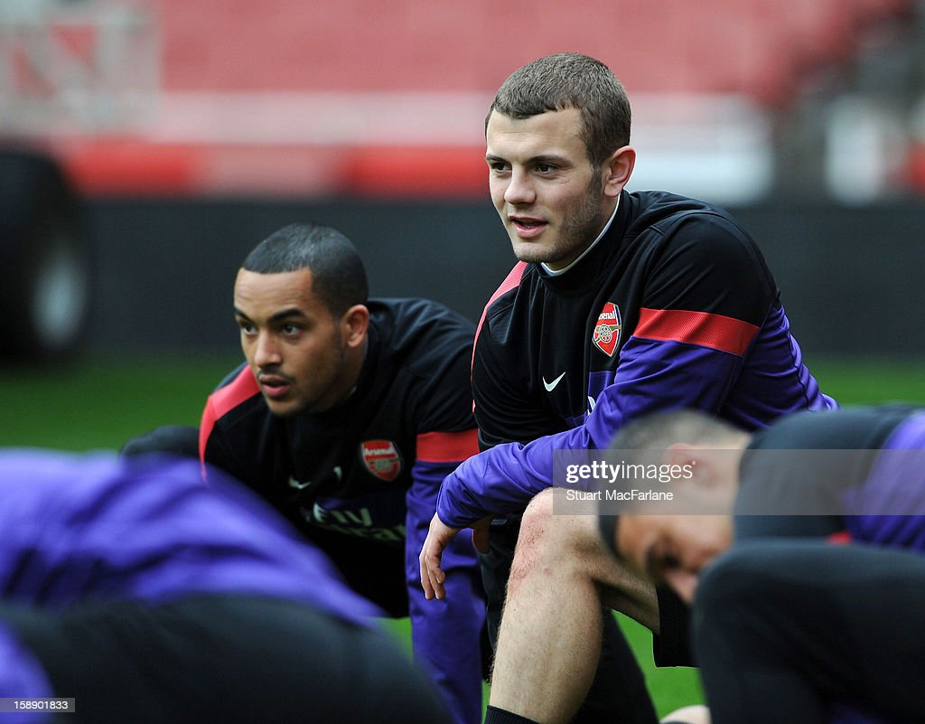 Theo Walcott and Jack Wilshere of Arsenal look on during a training session at Emirates Stadium on January 03, 2013 in London, England.