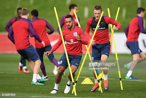 Theo Walcott and Jamie Vardy of England warm up during an England training session ahead of the FIFA 2018 World Cup Group F Qualifier match against...