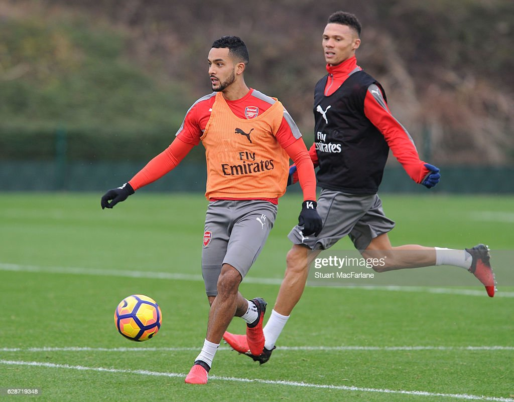 Theo Walcott and Kieran Gibbs of Arsenal during a training session at London Colney on December 9, 2016 in St Albans, England.