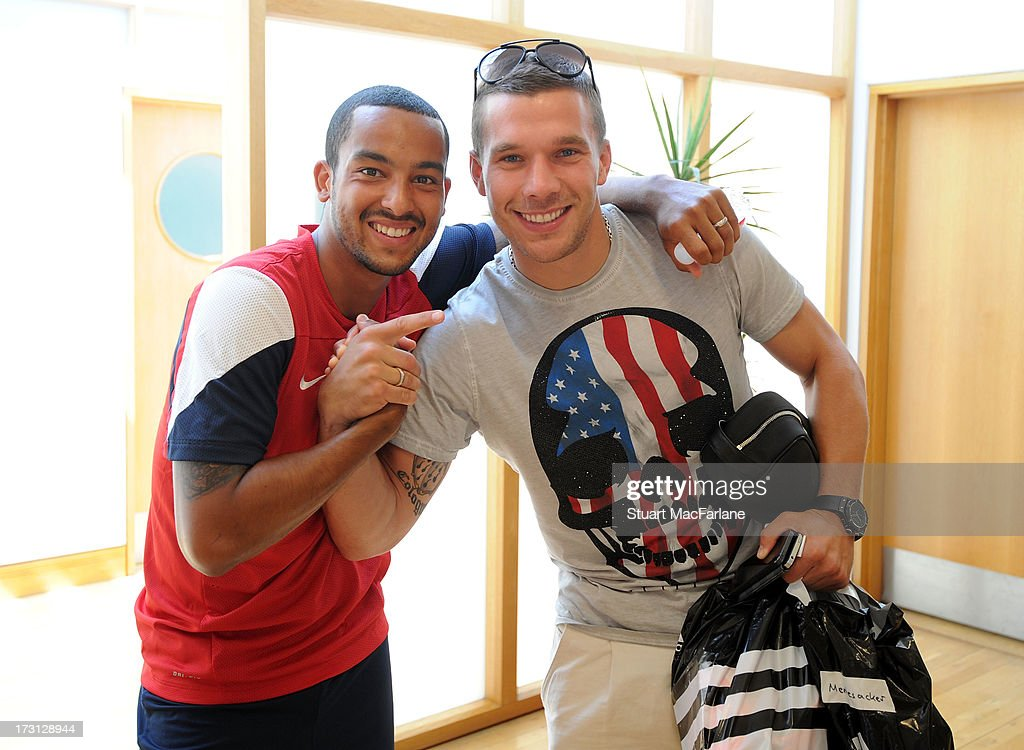 Theo Walcott and Lukas Podolski of Arsenal pose at London Colney on July 08, 2013 in St Albans, England.